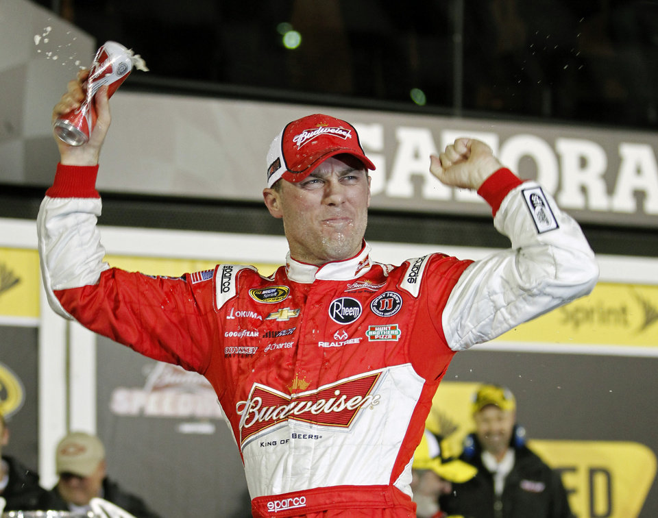 Photo - Kevin Harvick celebrates in Victory Lane after winning the NASCAR Sprint Unlimited auto race at Daytona International Speedway, Saturday, Feb. 16, 2013, in Daytona Beach, Fla. (AP Photo/Terry Renna)