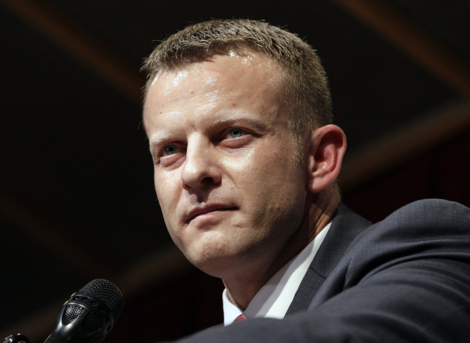 Photo - New Arkansas State head coach Bryan Harsin speaks during an NCAA college football news conference in Jonesboro, Ark., Wednesday, Dec. 12, 2012. Harsin previously was the Texas co-offensive coordinator and replaces Gus Malzahn, who left after one season to coach at Auburn. (AP Photo/Danny Johnston)