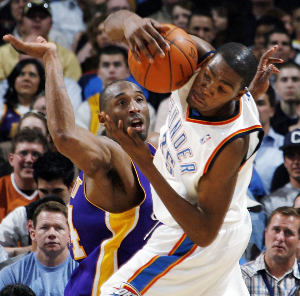Photo - Oklahoma City's Kevin Durant (35) tries to keep control of the ball next to Kobe Bryant (24) of Los Angeles during the NBA basketball game between the Los Angeles Lakers and the Oklahoma City Thunder at the Ford Center in Oklahoma City, Friday, March 26, 2010. Oklahoma City won, 91-75. [Nate Billings/The Oklahoman]