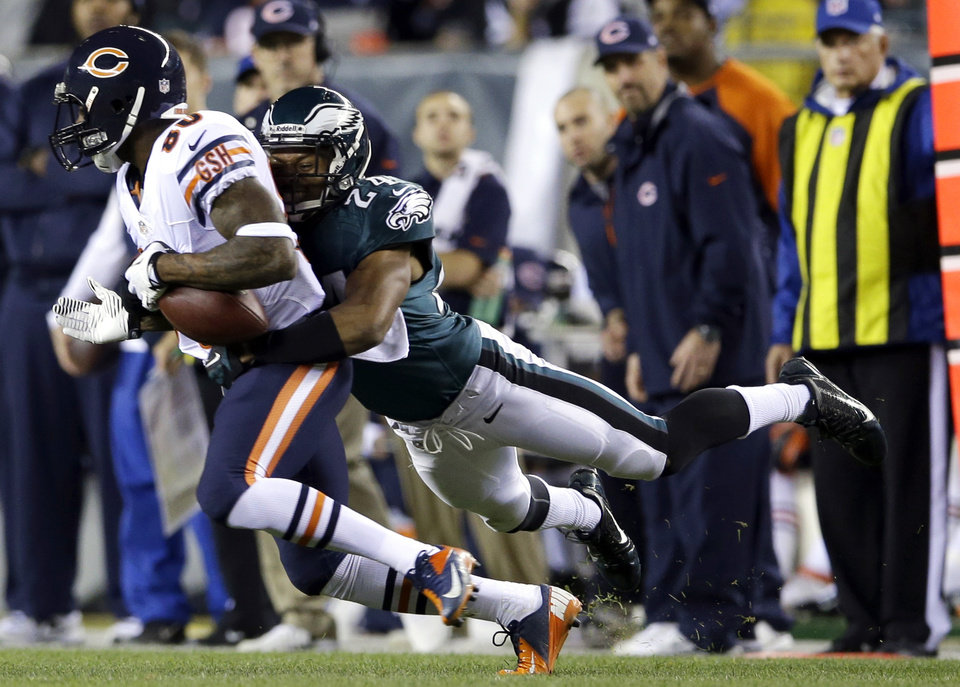 Photo - Chicago Bears' Earl Bennett, left, is tackled by Philadelphia Eagles' Bradley Fletcher during the first half of an NFL football game, Sunday, Dec. 22, 2013, in Philadelphia. (AP Photo/Michael Perez)