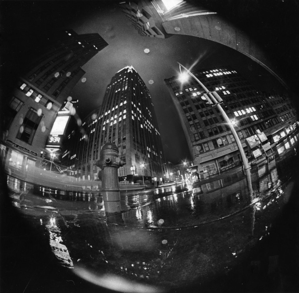 OKLAHOMA CITY / SKY LINE / OKLAHOMA / DOWNTOWN:  FISHY EYE VIEW of downtown Oklahoma City testifies to the inclement weather Monday night.  And if the great outdoors seemed like the inside of a damp aquarium to residents on the streets, it was just about the same to the camera of Oklahoma Staff Photographer Dave Heaton armed with a fisheye lens on his camera.  Staff photo by Dave Heaton.  Photo dated 01/22/1968 and published on 01/23/1968 and 01/29/1968 in The Daily Oklahoman.