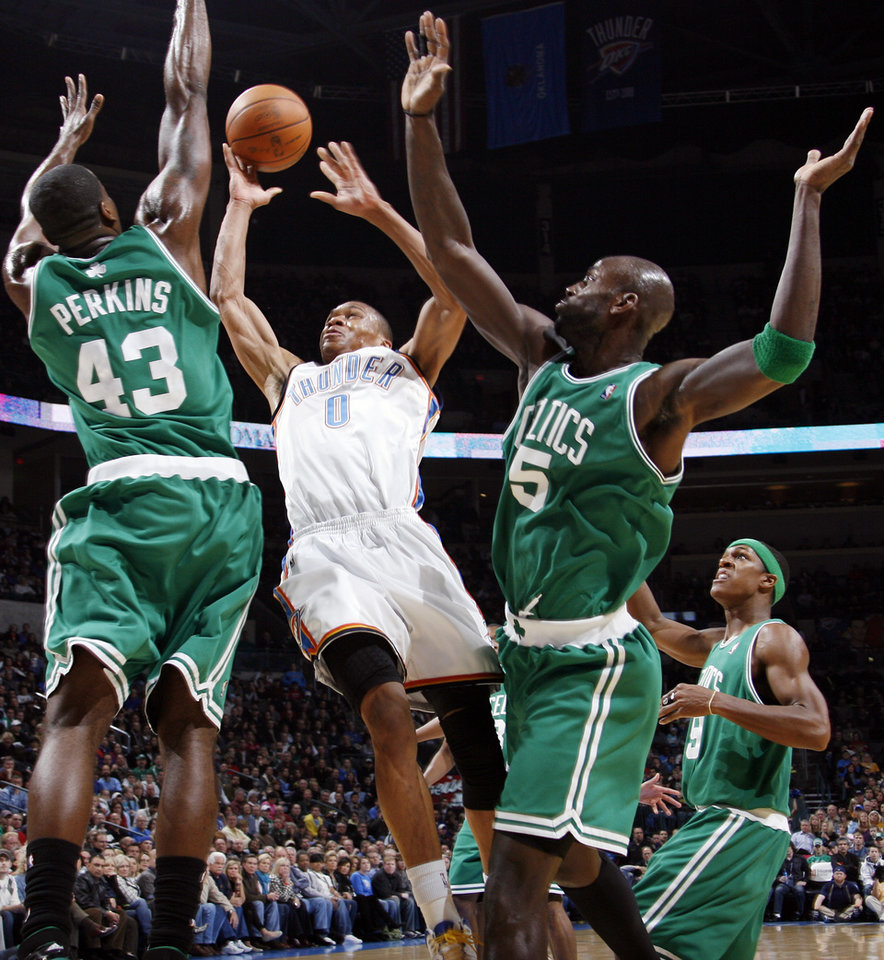 Photo - ALTERNATE CROP: Oklahoma City's Russell Westbrook takes a shot between Kendrick Perkins (43) and Kevin Garnett (5) of Boston as Rajon Rondo (9) looks on in the first half of the NBA basketball game between the Boston Celtics and the Oklahoma City Thunder at the Ford Center in Oklahoma City, Friday, Dec. 4, 2009. Photo by Nate Billings, The Oklahoman ORG XMIT: KOD