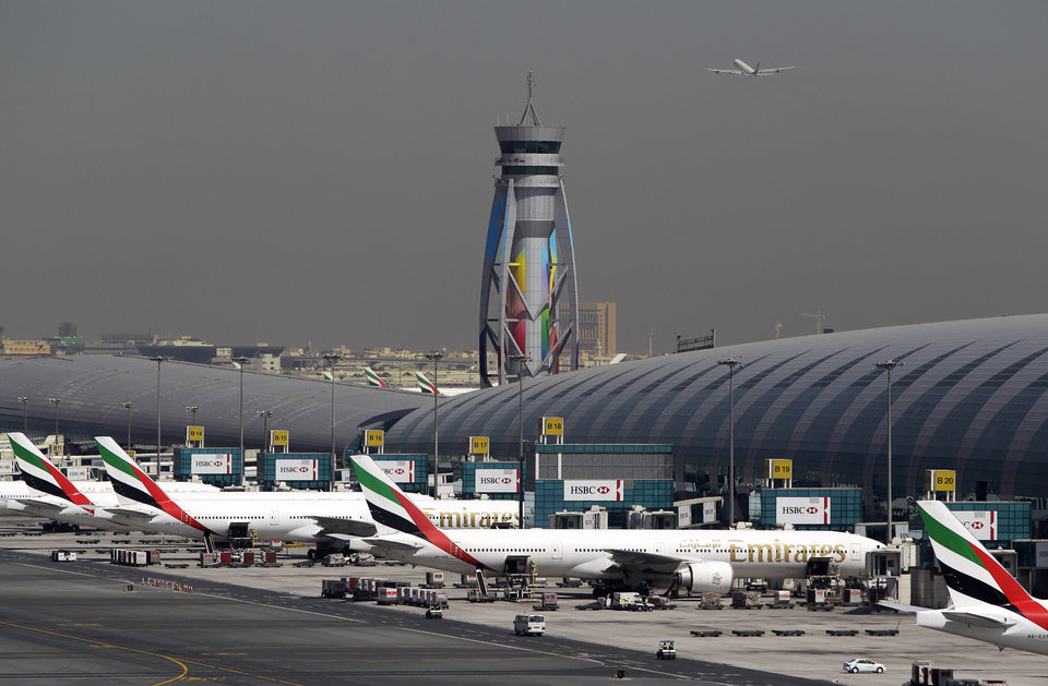 Photo - FILE - In this Thursday, May 8, 2014, file photo, Emirates passenger planes are parked at their gates at Dubai Airport in United Arab Emirates. Now that he's had a taste of running the world's busiest air hub for international passengers, the airport's CEO, Paul Griffiths, is determined to hang on to the honor while setting his sights on an even bigger prize: beating Atlanta for the title of busiest airport on the planet. (AP Photo/Kamran Jebreili, File)