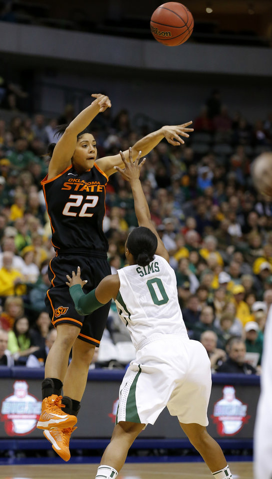 Photo - Oklahoma State's Brittney Martin (22) passes the ball over Baylor's Odyssey Sims (0) during the Big 12 tournament women's college basketball game between Oklahoma State University and Baylor at American Airlines Arena in Dallas, Sunday, March 10, 2012.  Photo by Bryan Terry, The Oklahoman