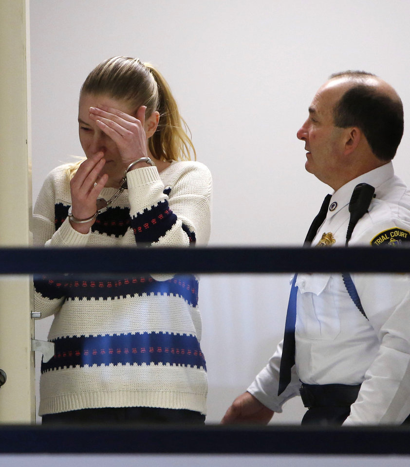 Photo - Irish nanny Aisling McCarthy Brady appears at Middlesex Superior Court, Thursday, April 18, 2013, in Woburn, Mass. Brady accused of violently injuring and killing one-year-old Rehma Sabir of Cambridge, Mass., in her care is facing a murder charge. (AP Photo/Bizuayehu Tesfaye, Pool)