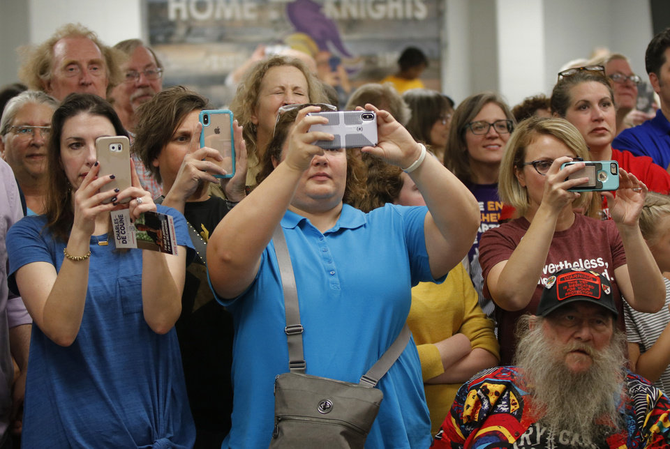 Photo - The crowd captures the event on their phones as U.S. Senator and NWC Alum, Class of '66 Elizabeth Warren speaks at the AFT education rally at Northwest Classen High School, Saturday, September, 22, 2018.  Photo by Doug Hoke, The Oklahoman