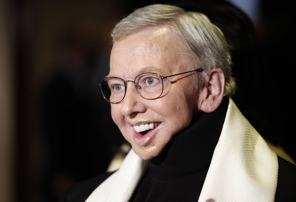 FILE - This Jan. 2009 file photo shows film critic and author Roger Ebert, recipient of the Honorary Life Member Award, at the Directors Guild of America Awards in Los Angeles. The Chicago Sun-Times is reporting that its film critic Roger Ebert died on Thursday, April 4, 2013. He was 70. (AP Photo/Matt Sayles, file) ORG XMIT: NYET831