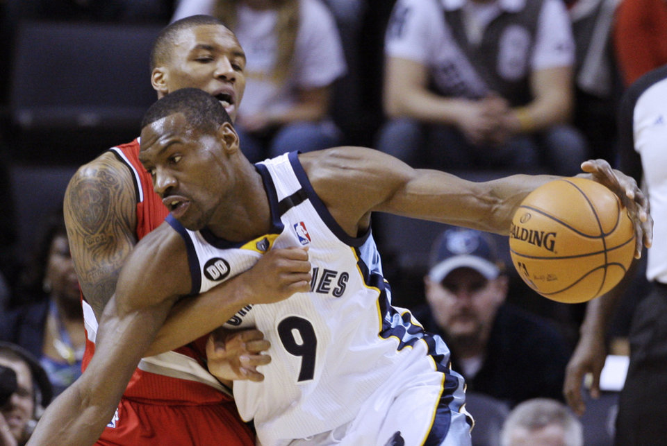 Memphis Grizzlies' Tony Allen (9) is fouled by Portland Trail Blazers' Damian Lillard during first half of an NBA basketball game in Memphis, Tenn., Wednesday, March 6, 2013. (AP Photo/Danny Johnston)