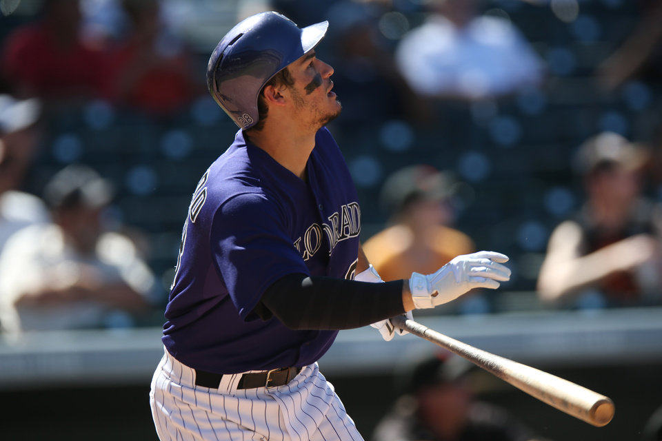 Photo - Colorado Rockies' Nolan Arenado watches his three-run home run against the San Francisco Giants in the fifth inning of the Rockies' 9-2 victory in a baseball game in Denver on Wednesday, Sept. 3, 2014. (AP Photo/David Zalubowski)