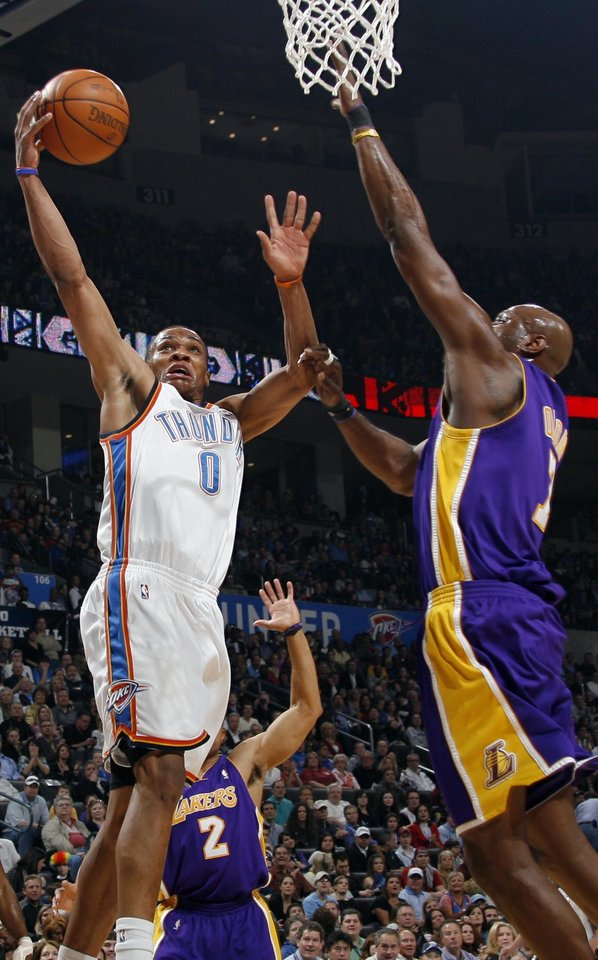 Russell Westbrook (0) of Oklahoma City shoots over Lamar Odom (7) of Los Angeles during the NBA basketball game between the Los Angeles Lakers and the Oklahoma City Thunder at the Ford Center in Oklahoma City, Friday, March 26, 2010. Photo by Nate Billings, The Oklahoman