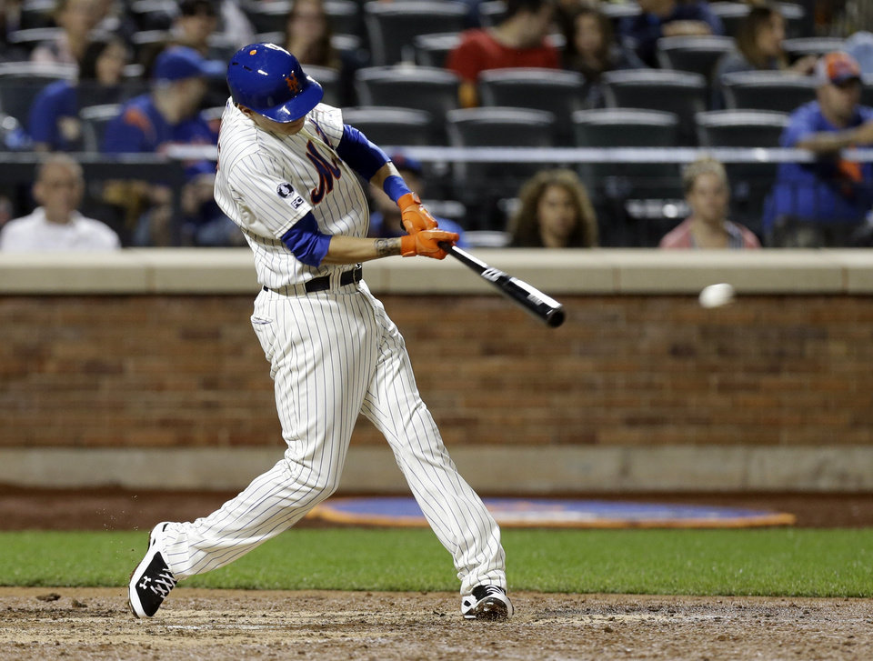 Photo - New York Mets' Wilmer Flores hits a two-run double during the seventh inning of a baseball game against the San Francisco Giants Saturday, Aug. 2, 2014, in New York. (AP Photo/Frank Franklin II)