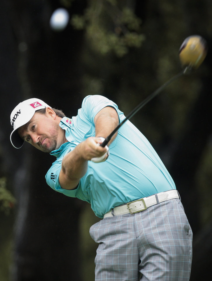 Photo - Graeme McDowell tees off on the sixth hole during the second round of the World Challenge golf tournament at Sherwood Country Club in Thousand Oaks, Calif., Friday, Nov. 30, 2012. (AP Photo/Bret Hartman)