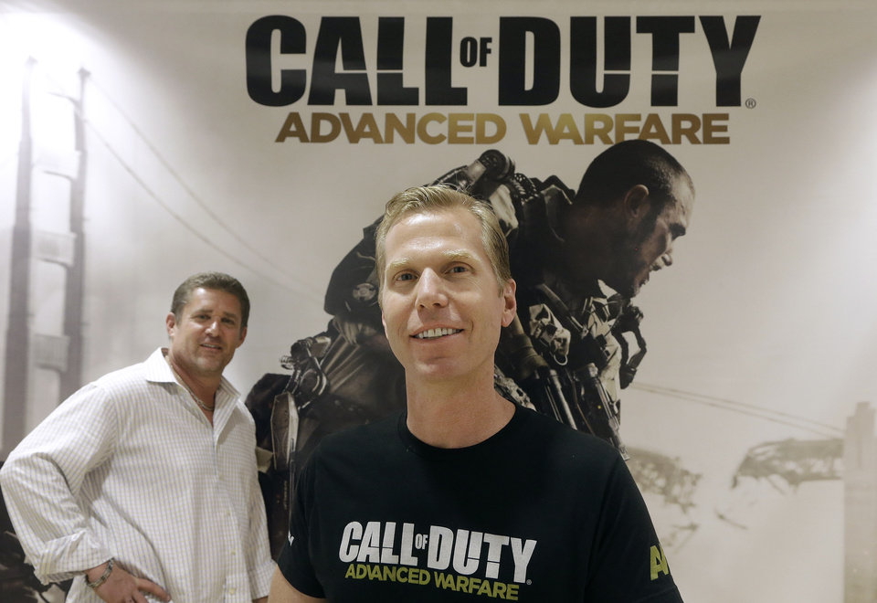 Photo - This July 31, 2014 shows Glen Schofield, left, and Michael Condrey, co-founders of Sledgehammer Games in front of a