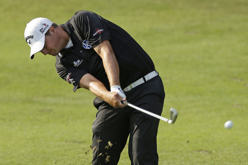 Photo - Brian Stuard hits to the ninth green during the second round of the Wyndham Championship golf tournament in Greensboro, N.C., Friday, Aug. 15, 2014. (AP Photo/Chuck Burton)
