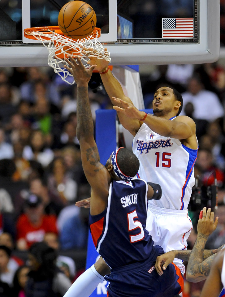 Atlanta Hawks forward Josh Smith (5) and Los Angeles Clippers center Ryan Hollins (15) fight for a loose ball in the first half of an NBA basketball game on Sunday, Nov. 11, 2012, in Los Angeles. (AP Photo/Gus Ruelas)