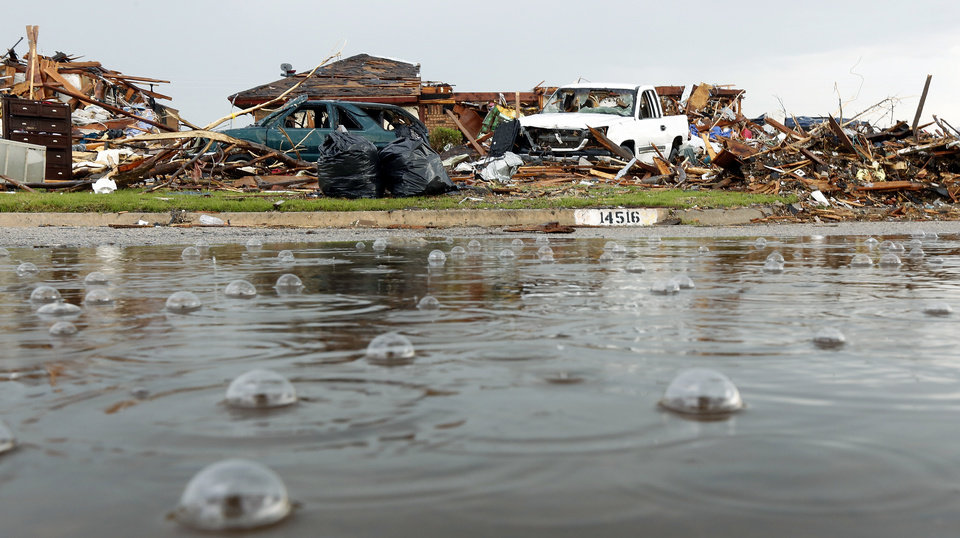 Photo - Rain falls on homes damaged by Monday's massive tornado on Brent Dr. in Oklahoma City , Thursday May 23, 2013.Photo By Steve Gooch, The Oklahoman