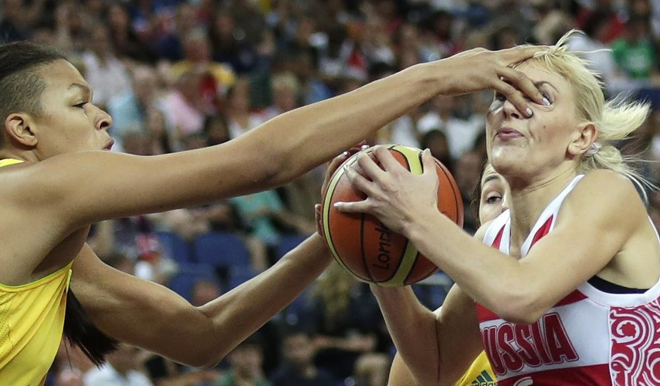 Photo -   Australia's Elizabeth Cambage jams her finger into the eye of Russia's Natalya Vodopyanova while defending a drive to the basket during a women's bronze medal basketball game at the 2012 Summer Olympics, Saturday, Aug. 11, 2012, in London. (AP Photo/Charles Krupa)