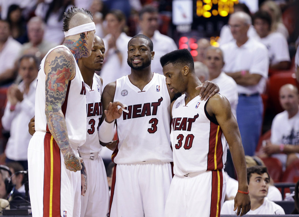 Photo - From left, Miami Heat forward Chris Andersen, guard Ray Allen, guard Dwyane Wade and guard Norris Cole huddle during the second half of Game 2 of their NBA basketball playoff series in the Eastern Conference semifinals against the Chicago Bulls, Wednesday, May 8, 2013, in Miami. The Heat won 115-78. (AP Photo/Lynne Sladky)