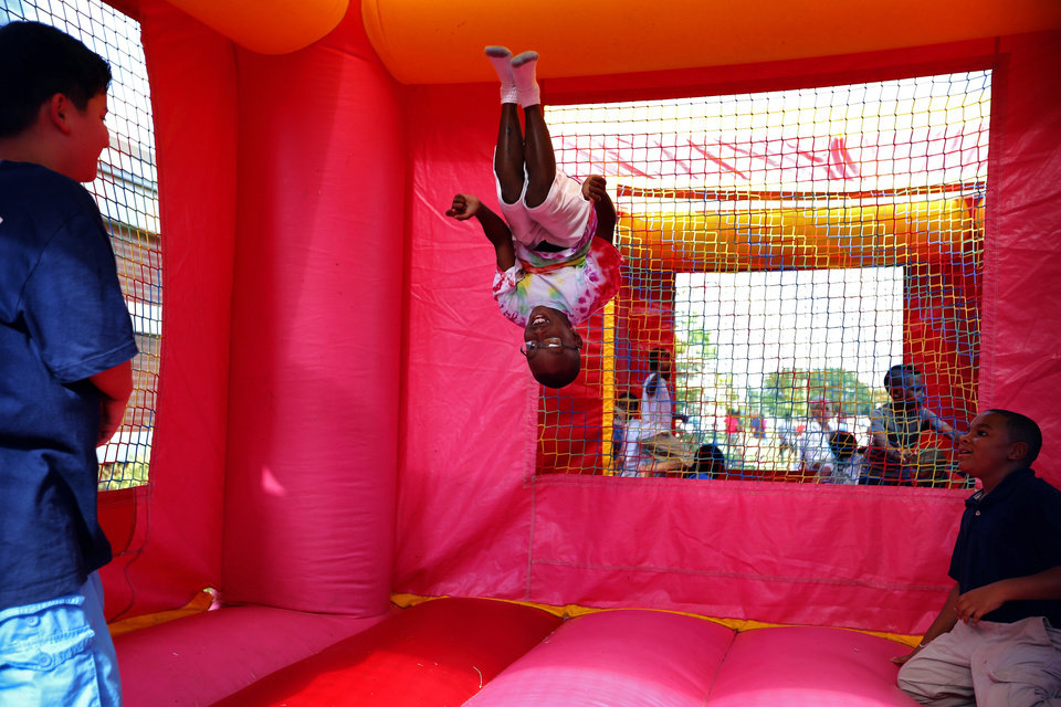 Keshaun James, 9, does a back flip during a back-to-school bash at Greystone Upper Elementary School in Oklahoma City, Thursday, Aug 8, 2013. Photo by Sarah Phipps, The Oklahoman