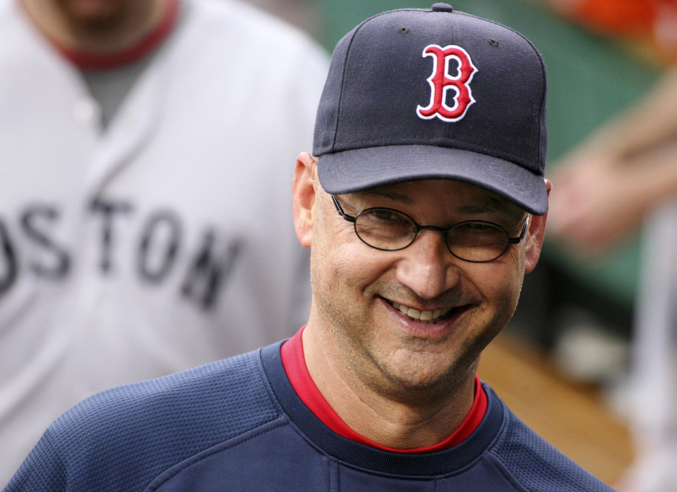 Photo -   FILE - In this June 24, 2011, file photo, Boston Red Sox manager Terry Francona walks in the dugout before an interleague baseball game against the Pittsburgh Pirates in Pittsburgh. A person familiar with the decision says the Cleveland Indians on Saturday, Oct. 6, 2012, have chosen Francona to be their next manager and are working with him on a contract. (AP Photo/Gene J. Puskar, File)