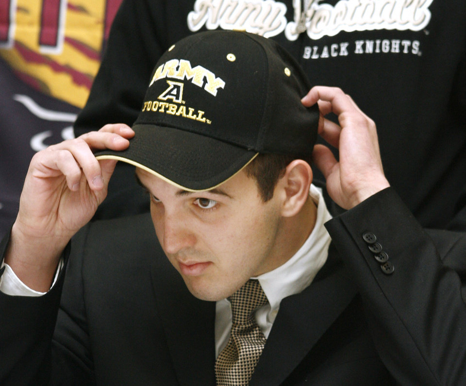 Photo -  Hunter Frantz puts on an Army hat after signing to play at West Point during a signing ceremony at Putnam City North High School in Oklahoma City Wednesday, Feb. 4, 2009. BY PAUL B. SOUTHERLAND, THE OKLAHOMAN