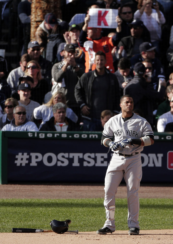 Photo -   New York Yankees' Robinson Cano reacts after striking out in the first inning during Game 4 of the American League championship series against the Detroit Tigers Thursday, Oct. 18, 2012, in Detroit. (AP Photo/Charlie Riedel)