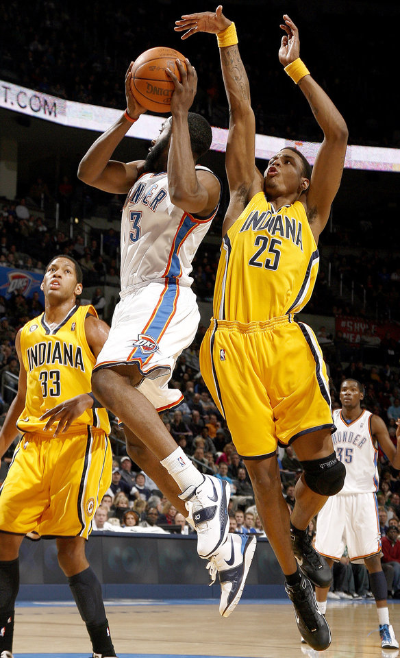 Oklahoma City's James Harden (13) looks to pass as Indiana's Brandon Rush (25) and Danny Granger (33) defend during the basketball game between the Oklahoma City Thunder and the Indiana Pacers, Saturday, Jan. 9, 2010 at the Ford Center in Oklahoma CIty. Photo by Sarah Phipps, The Oklahoman