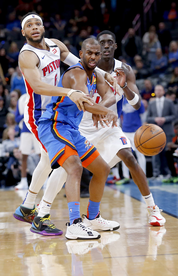 Photo - Oklahoma City's Chris Paul (3) is fouled by Detroit's Bruce Brown (6) during NBA basketball game between the Oklahoma City Thunder and the Detroit Pistons at the Chesapeake Energy Arena in Oklahoma City, Friday, Feb. 7, 2020.  [Sarah Phipps/The Oklahoman]