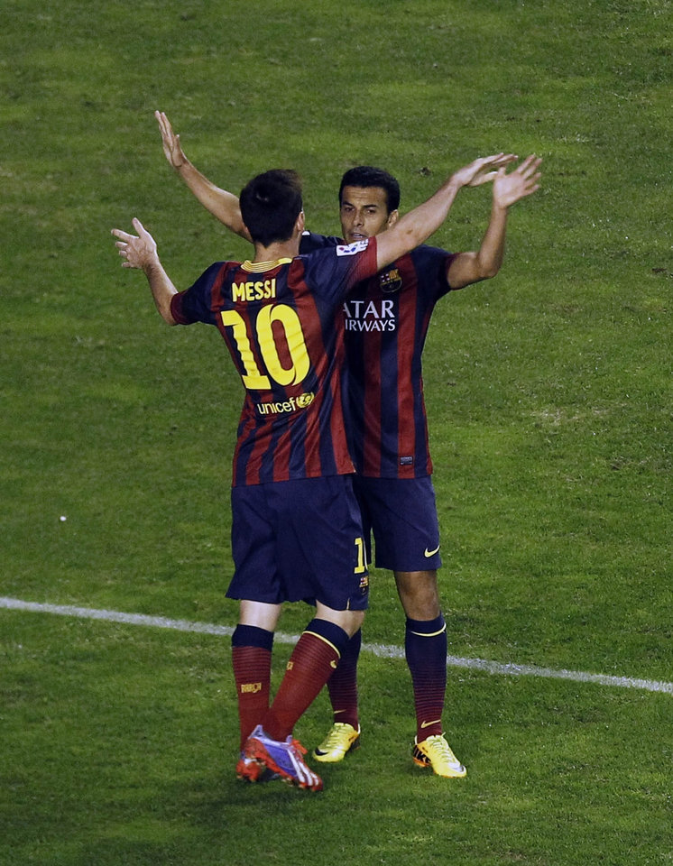 Photo - FC Barcelona's Pedro Rodriguez, right,  celebrates his goal with Lionel Messi from Argentina, left, during a Spanish La Liga soccer match against Rayo Vallecano at the Vallecas stadium in Madrid, Spain, Saturday, Sept. 21, 2013. (AP Photo/Andres Kudacki)