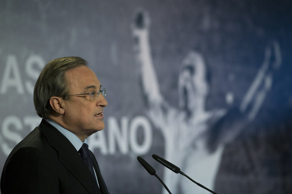 Photo - Real Madrid's President Florentino Perez speaks in front of a poster of Alfredo Di Stefano in Madrid, Spain, Monday, July 7, 2014 after football great Alfredo Di Stefano died. He was 88. The former Argentina forward was hospitalized on Saturday after a heart attack. He had been in a coma since at Gregorio Maranon hospital in the Spanish capital where he passed away. Di Stefano helped Madrid win five straight European Champions Cups from 1956-60 and eight Spanish league titles. He was voted European player of the year in 1957 and 1959. (AP Photo/Paul White)