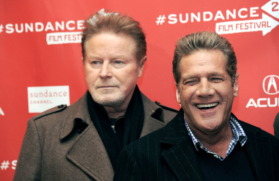 """Glenn Frey, left, and Don Henley of The Eagles pose together at the premiere of the documentary film """"History of The Eagles Part 1"""" at the 2013 Sundance Film Festival, Saturday, Jan. 19, 2013, in Park City, Utah. (Photo by Chris Pizzello/Invision/AP)"""