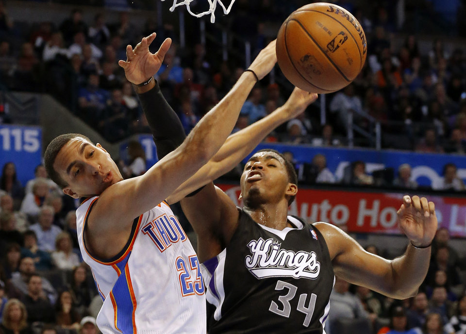 Oklahoma City\'s Kevin Martin (23) is fouled by Sacramento\'s Jason Thompson (34) during an NBA basketball game between the Oklahoma City Thunder and the Sacramento Kings at Chesapeake Energy Arena in Oklahoma City, Friday, Dec. 14, 2012. Photo by Bryan Terry, The Oklahoman