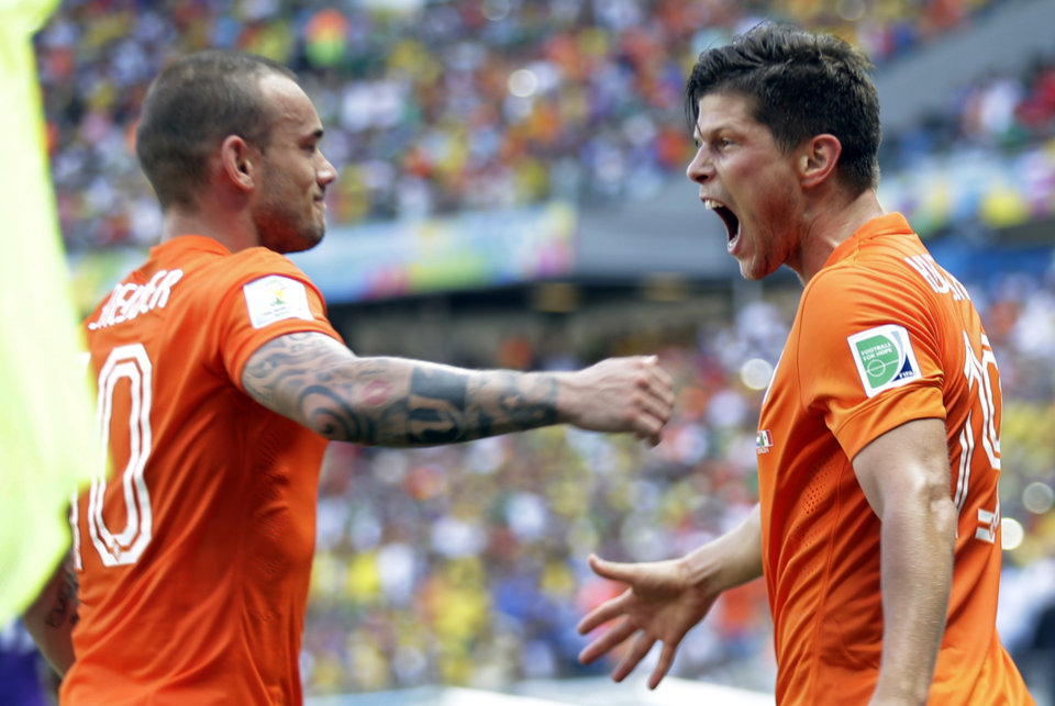 Photo - Netherlands' Klaas-Jan Huntelaar, right, celebrates with Wesley Sneijder after scoring his side's second goal during the World Cup round of 16 soccer match between the Netherlands and Mexico at the Arena Castelao in Fortaleza, Brazil, Sunday, June 29, 2014. The Netherlands won the match 2-1. (AP Photo/Natacha Pisarenko)