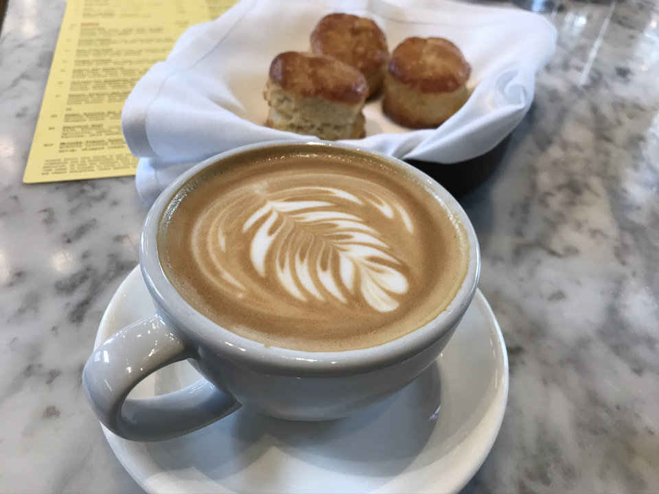 Photo - Cappucino and biscuits at The Jones Assembly in Oklahoma City. [Dave Cathey/The Oklahoman]