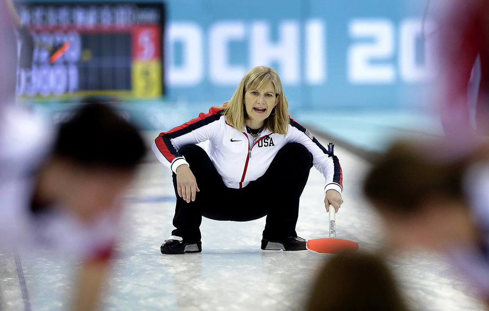 Photo - Erika Brown, skip for the United States, shouts instructions to her teammates during the women's curling competition againt Russia at the 2014 Winter Olympics, Tuesday, Feb. 11, 2014, in Sochi, Russia. (AP Photo/Wong Maye-E)