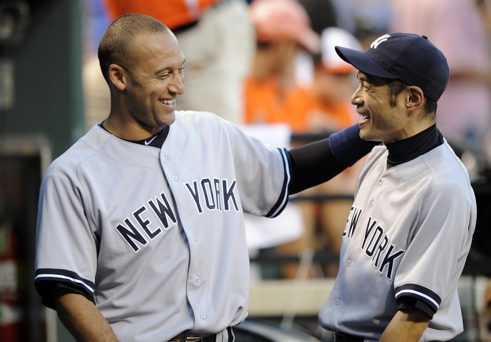 Photo -   New York Yankees' Derek Jeter, left, and Ichiro Suzuki, of Japan, laugh in the dugout before a baseball game against the Baltimore Orioles, Thursday, Sept. 6, 2012, in Baltimore. (AP Photo/Nick Wass)
