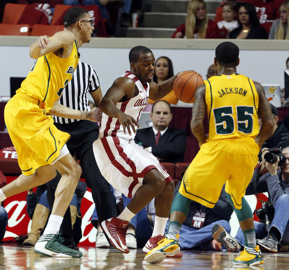 Oklahoma Sooner's Sam Grooms (1) gets a rebound between Baylor Bear's Isaiah Austin (21) and Pierre Jackson (55) as the University of Oklahoma Sooners (OU) men play the Baylor University Bears (BU) in NCAA, college basketball at The Lloyd Noble Center on Saturday, Feb. 23, 2013  in Norman, Okla. Photo by Steve Sisney, The Oklahoman
