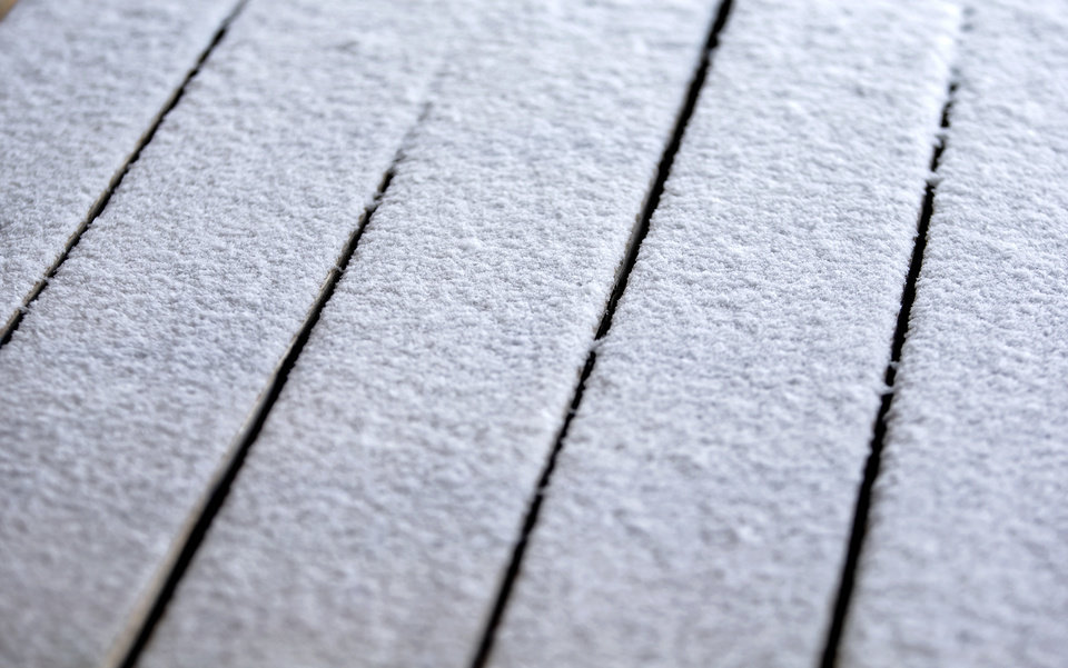 Photo - A light coat of snow covers a picnic table in Oklahoma City, Okla. on Wednesday, Feb. 5, 2020.  [Chris Landsberger/The Oklahoman]