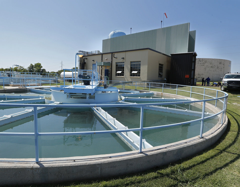 Photo -  Water flows through a clarifier at the Norman's water treatment plant. Voters will be asked to approve a water rate hike Jan. 13 that would help fund improvements to the plant on E Robinson Street. The Oklahoman Archives   STEVE SISNEY -