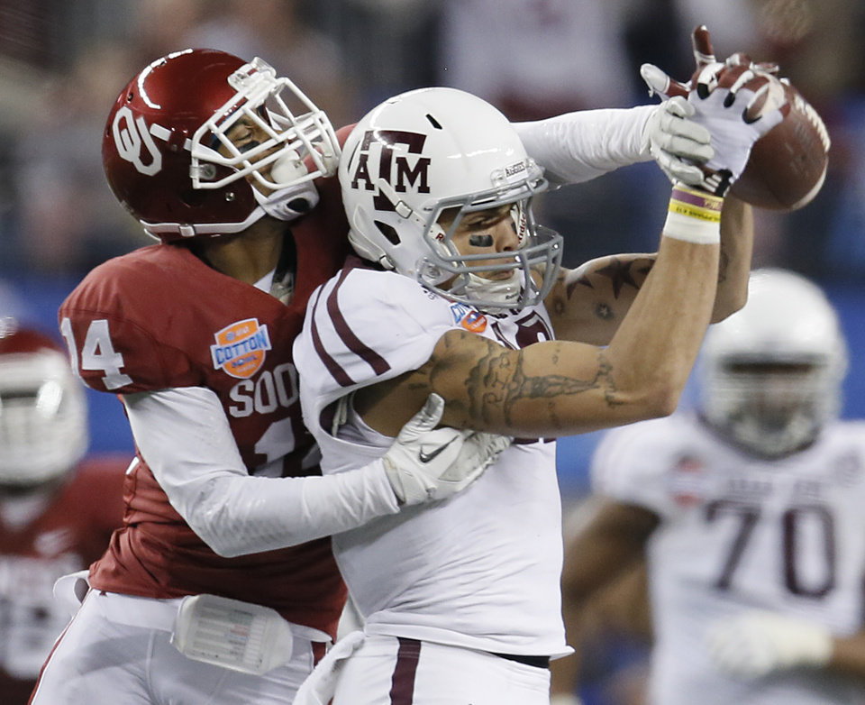 Texas A&M\'s Mike Evans (13) makes a catch in front of Oklahoma\'s Aaron Colvin (14) during the college football Cotton Bowl game between the University of Oklahoma Sooners (OU) and Texas A&M University Aggies (TXAM) at Cowboy\'s Stadium on Friday Jan. 4, 2013, in Arlington, Tx. Photo by Chris Landsberger, The Oklahoman