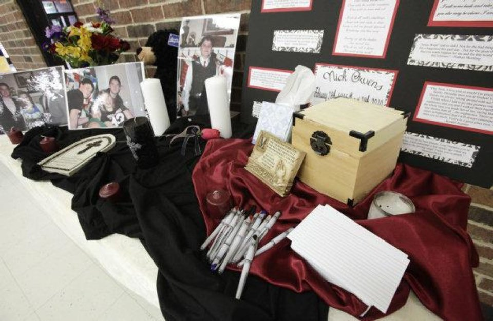 Photo - Pictures of Nick Owens and his family and a box for friends to share thoughts and prayers are part of a memorial at Putnam City North High School. The 15-year-old sophomore was killed Sunday in a traffic accident. PHOTO BY PAUL B. SOUTHERLAND, THE OKLAHOMAN  PAUL B. SOUTHERLAND - PAUL B. SOUTHERLAND