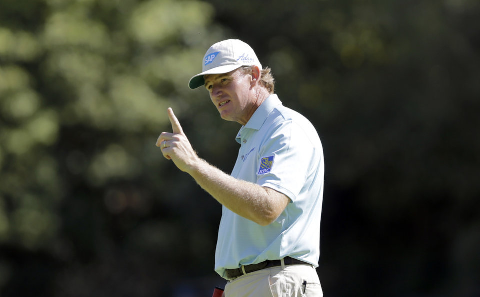 Photo - Ernie Els, of South Africa, stands on the 14th green in the Pro-Am round of the Northern Trust Open golf tournament at Riviera Country Club in the Pacific Palisades area of Los Angeles, Wednesday, Feb. 12, 2014. (AP Photo/Reed Saxon)