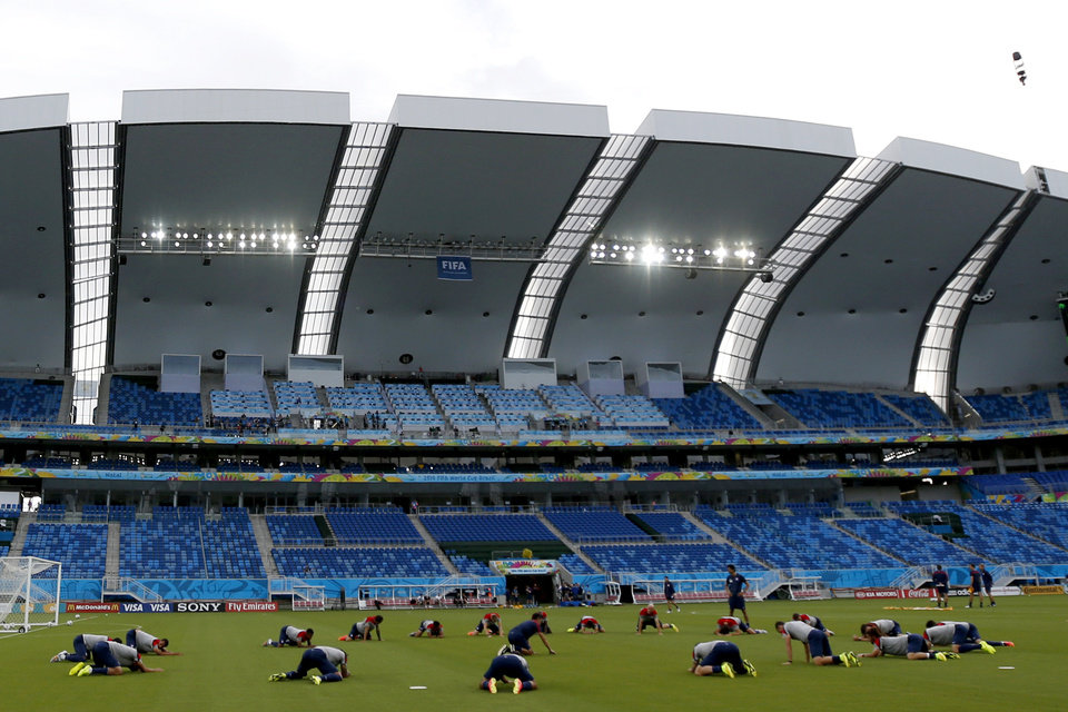 Photo - United States national soccer players stretch during an official training session the day before the group G World Cup soccer match between Ghana and the United States at the Arena das Dunas in Natal, Brazil, Sunday, June 15, 2014.  (AP Photo/Julio Cortez)