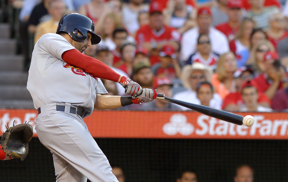 Photo - St. Louis Cardinals' Daniel Descalso breaks his bat as he hits an RBI double during the second inning of the Cardinals' baseball game against the Los Angeles Angels, Wednesday, July 3, 2013, in Anaheim, Calif. (AP Photo/Mark J. Terrill)