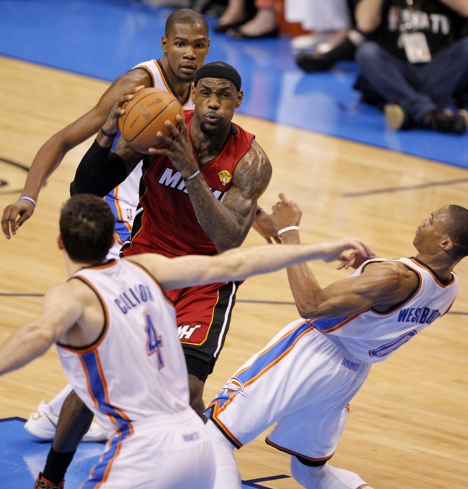 Miami's LeBron James (6) goes to the basket between Oklahoma City 's Nick Collison (4), Kevin Durant, and Russell Westbrook during Game 1 of the NBA Finals between the Oklahoma City Thunder and the Miami Heat at Chesapeake Energy Arena in Oklahoma City, Tuesday, June 12, 2012. Photo by Nate Billings, The Oklahoman