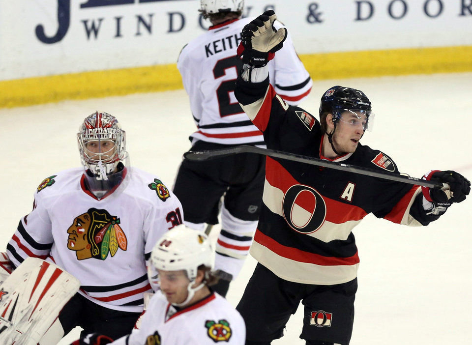 Photo - Ottawa Senators' Kyle Turris (7) celebrates a goal by teammate Cory Ceci as Chicago Blackhawks goaltender Antti Raanta, left, of Finland, looks on during first-period NHL hockey game action in Ottawa, Ontario, Friday, March 28, 2014. (AP Photo/The Canadian Press, Fred Chartrand)