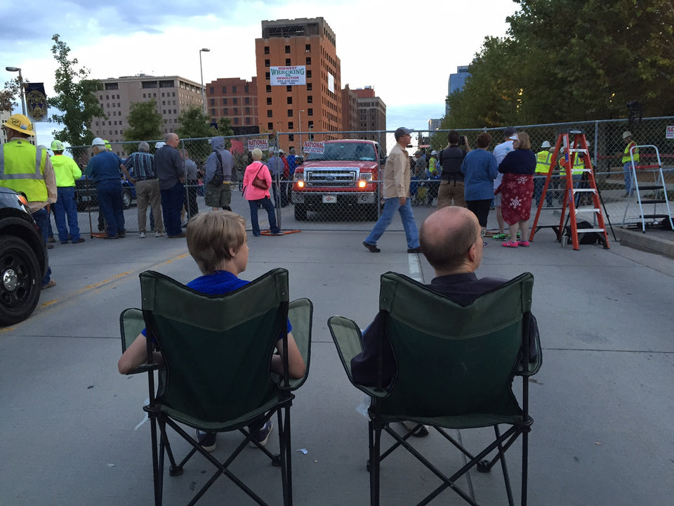 Photo - Scott Wallace and son, Matthew, 13, Oklahoma City, have front row seats to watch the implosion. Scott also watched the Biltmore implosion and the Belle Isle demolition. He thinks he was about his son's age when he watched the Biltmore go down.  Photo by Jim Beckel