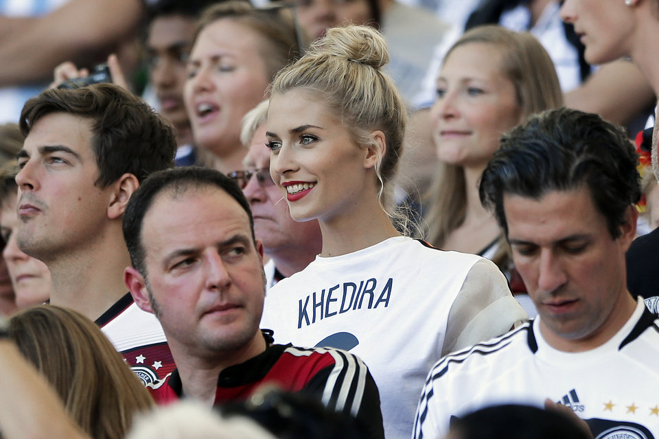Photo - Lena Gercke, the girlfriend of Germany's Sami Khedira, waits for the start of the World Cup final soccer match between Germany and Argentina at the Maracana Stadium in Rio de Janeiro, Brazil, Sunday, July 13, 2014. (AP Photo/Matthias Schrader)