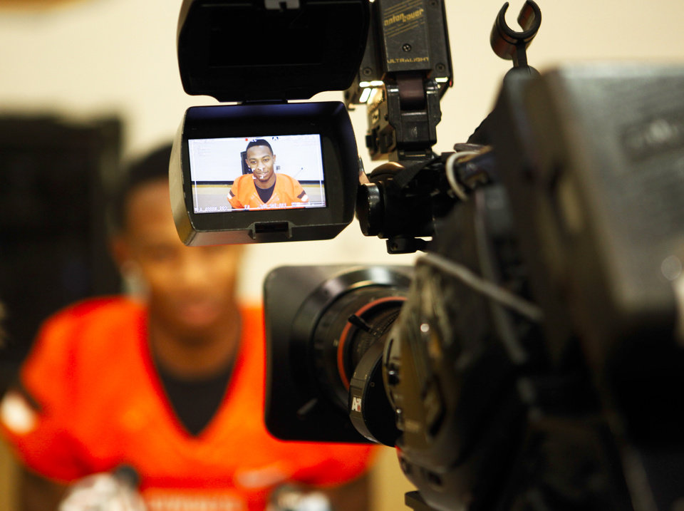 Seen through a broadcast camera viewfinder, Oklahoma State cornerback Justin Gilbert speaks to reporters at the Oklahoma State football media day held at Gallagher-Iba Arena in Stillwater on August 3, 2013. KT King, For The Oklahoman