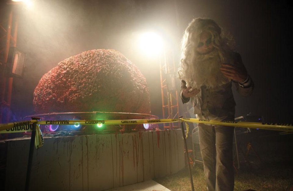 Photo -  Trick or treaters looks at the Flaming Lips lead singer Wayne Coyne's 500-pound human brain, Saturday Oct. 30, 2010, at his home in Oklahoma City. Photo by Sarah Phipps, The Oklahoman